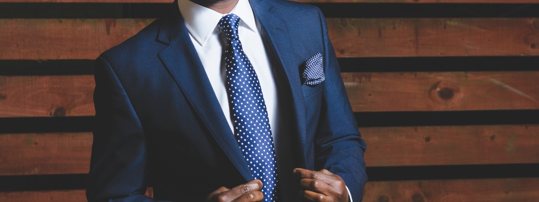 Man with blue formal suit and tie